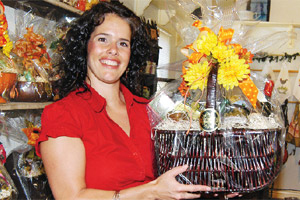 The gift baskets sold in Maisie Jane Hurtado's store and online business often include a variety of her own nut products as well as other items from local agricultural producers.