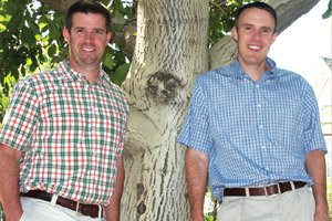 Fourth-generation  farmers Gus Mariani, left, and his brother Matt are actively  involved in their  family's growing and packing business,  which exports California walnuts to consumers  as far away as  Europe and Asia.