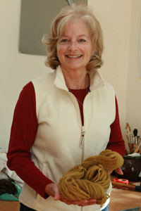 Janet Baldridge plans to use the wool she dyed at the event to knit a pair of socks.