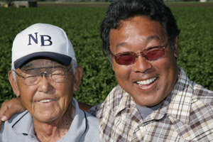 Tom Ikda, right, looks to his uncle Kaz Ikeda as an invaluable farming resource. Kaz, now 90, has been farming in the area since the late 1920s.