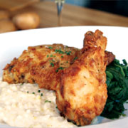 Buttermilk fried chicken with whipped potatoes and braised greens