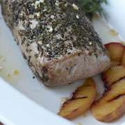 Herb roasted pork loin with grilled peaches and limoncello glaze