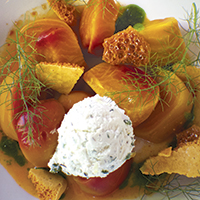 Roasted beet salad with herbed chevre, honeycomb and orange-beet reduction
