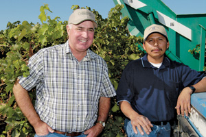 San Joaquin county farmer Joe Valente, left, values the contributions of the many long-term employees at Kautz Farms. Robert Camargo, right, started 20 years ago as a field laborer and now works as head mechanic.